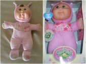 Pink Cabbage Patch Kids Cute and Cuddly - Pink Cabbage Patch Kids doll, green eyes with brown curly hair, but I think I can trick her with the one on the right (same exact doll, blonde hair)