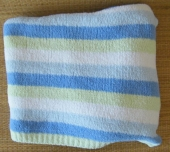 "Carter's ""Just One Year"" Cozy Chenille Blanket - Carter's cozy chenille blanket (blue, white, and yellow stripes) was lost on an international flight. Pretty sure it's gone forever but hoping to find a replacement that matches the photo. Thanks in advance for any leads!"
