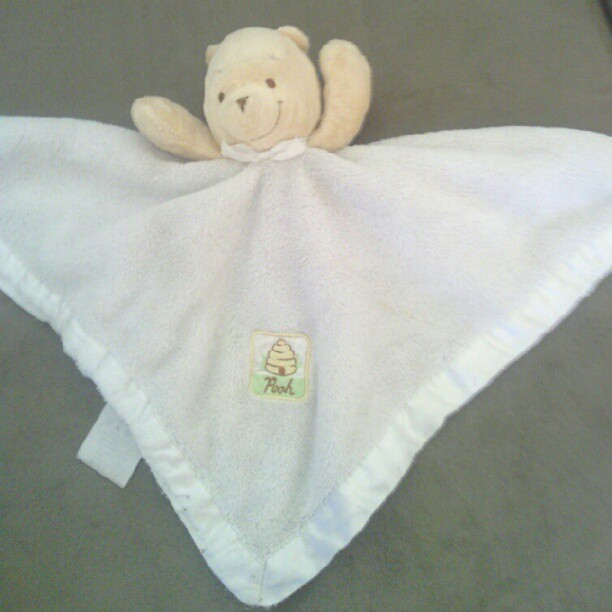 White pooh rattle lovey with beehive on front - whit winnie the pooh rattle lovey with beehive on the front. Kind of worn.