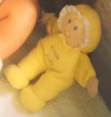 Yellow soft/rag doll called snuggle chums