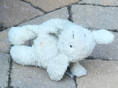 Raggedy jellycat lamb. Grayish, used to be white. Short ears, bean bag bottom and feet. Very slouchy