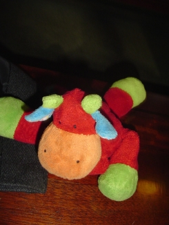 Multi coloured cow soft toy