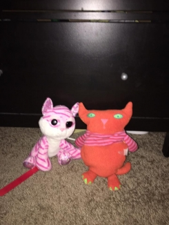 Stuffed cat - orange on front with green toes and a polka dot back