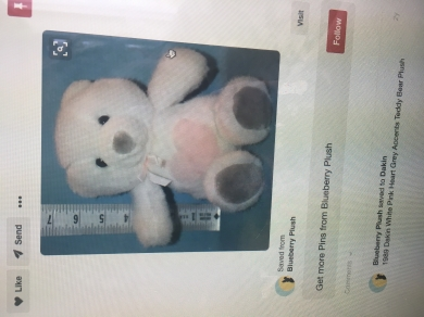 Small white teddy bear, pink heart on tummy, grey nose and feet. Well loved