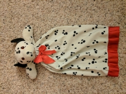 Dalmatian with a red bow tie and a heart on the chest.