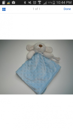 Blue puppy lovey with pacifier holder.