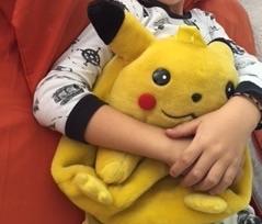 Pokémon/pikachu yellow plush back pack with some toys inside