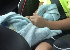 """Aqua Fleece Blanket with White  polka dots, says """"cute"""" in the center"""