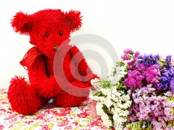 Red bear with black eyes, black nose, red ribbon bow