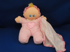 Yellow soft doll with bonnet and stitched face