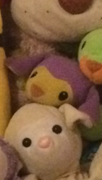 Purple TY Pillowpal Sheep with yellow face and inside of ears on on feet complete with yellow bow