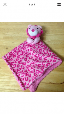 Pink lion lovey with leopard print on the blanket
