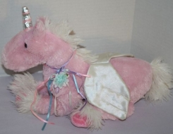 A Mart Pink floppy unicorn with flower ribbon