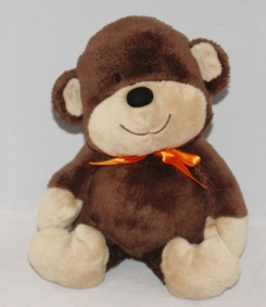 Carters brown stuffed monkey with orange bow around neck