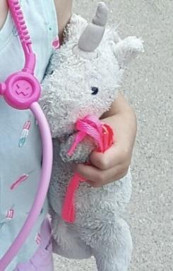 unicorn stuffed animal well worn. Now a light gray color