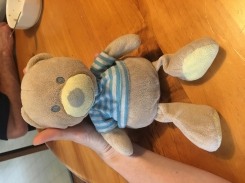 Tan bear with blue and white striped shirt