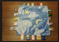 Blue plush Taggies blanket