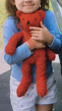 Red teddy bear with red bow, bead eyes and a sewn nose