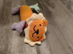 Orange and yellow lion with purple legs and blue/green tail