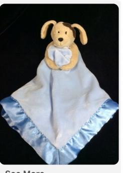 Tan dog holding blue blanket