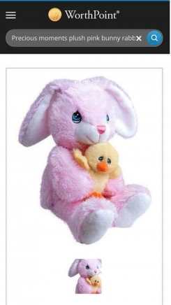 Precious moments pink bunny with floppy ears holding a yellow chick. Plush with beans in the bottom