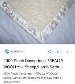 Dayspring comforter blanket.Small woolly blanket with satin material underneath and a plush lambs he