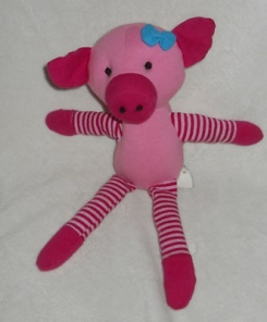 Plush pink pig with striped arms and legs; sold at Old Navy in 2008