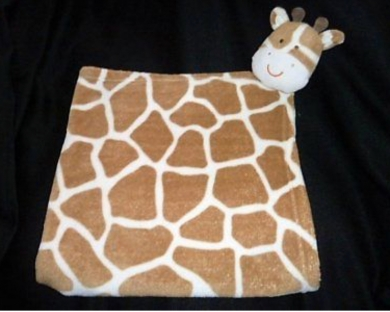 Giraffe patterned blanket with attached head