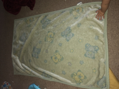 Mint green blanket with starts and teddy bears