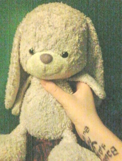 Lavender bunny short floppy legs arms and ears, easter egg on bottom of right foot