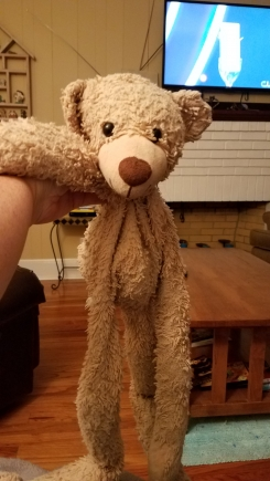 Hanging teddy with long legs and arms and velcro on hands,made by gund