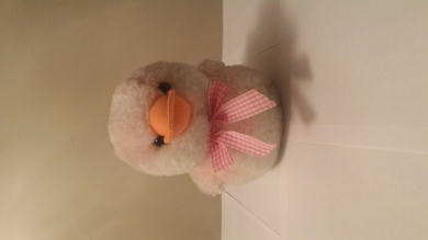 Pink and white duck with pink and white bow, orange beak, squeaky