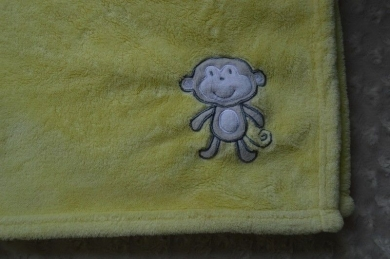 Yellow Circo Blanket with a Monkey in Corner